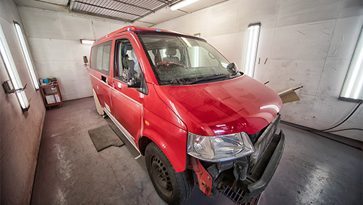 VW transporter in spray booth for accident repair